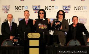 Gene Simmons (c) and Paul Stanley (with helmet) announce the new L.A. KISS arena football team in Orlando on 81/5/13. Photo by Arena Football League.